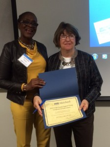 Board member and volunteer, Annette Ludlum, receiving the award on behalf of Donna Milstead